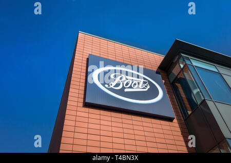 Sign for the store Boots on a modern building. - Stock Image