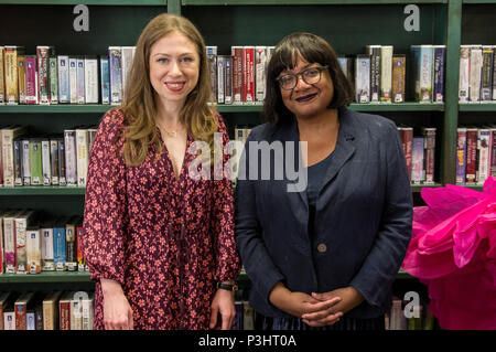 Chelsea Clinton poses with Diane Abbott in the library green room at the 2018 Stoke Newington Literary Festival in Hackney, East London - Stock Image