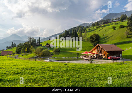 Small bathing lake in Hasliberg in the Swiss Alps. - Stock Image
