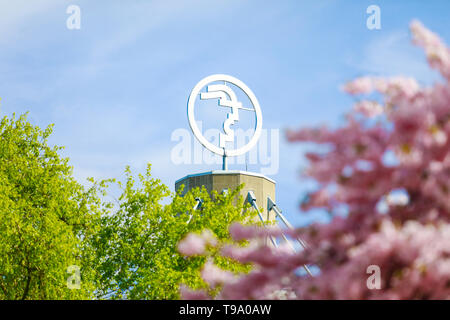 31.03.2019, Hannover, Lower Saxony, Germany - Logo of the Hannover Messe at the Hannover Messe, behind pink cherry blossom and green tree. 00X190331D0 - Stock Image
