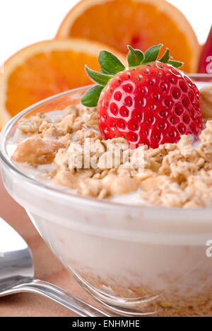 Muesli meal with fresh strawberry in a bowl. - Stock Image