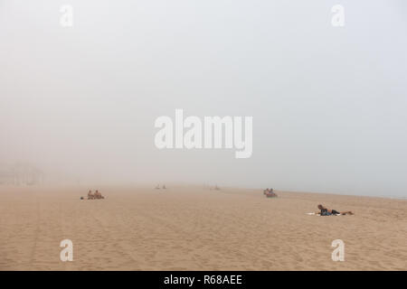 Benidorm, Costa Blanca, Spain, 4th December 2018. Sunbathers and swimmers left the beach early as a sea fret or cloudbank rolled in to Poniente and Levante beaches today in Benidorm on the Costa Blanca coast. Credit: Mick Flynn/Alamy Live News - Stock Image
