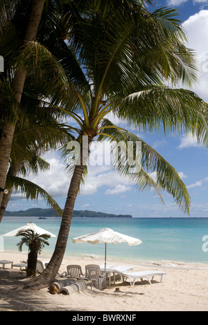A view of  beach chairs and umbrellas on Long Beach in Boracay, Philippines. - Stock Image