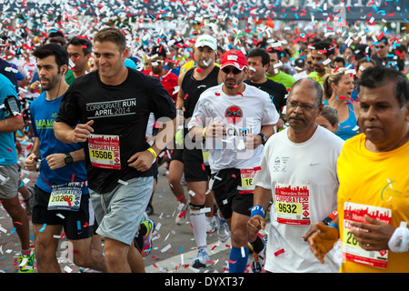 Throng of runners at start of 2014 Mercedes-Benz Corporate Run in Miami, Florida, USA. - Stock Image