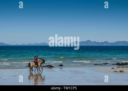 Beach riding at Hov, Gimsoya, Lofoten Islands, Norway. - Stock Image