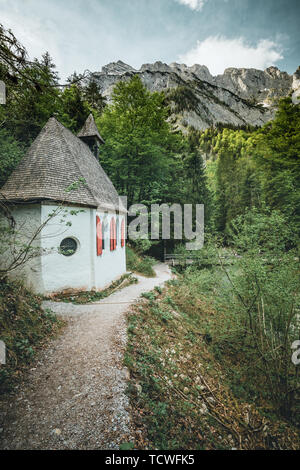 Beautiful scenery of a church in the national park st bartholomew with a bridge - Stock Image