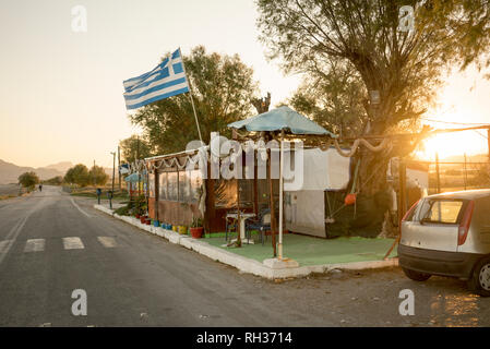 Greek flag near road - Stock Image