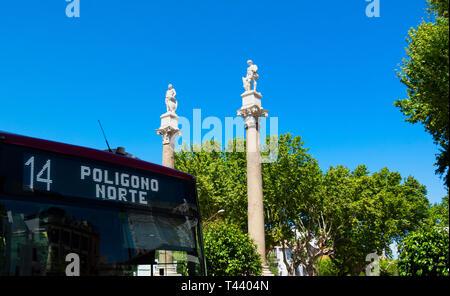 Statues on Roman columns in Alameda de Hercules in Seville - Stock Image