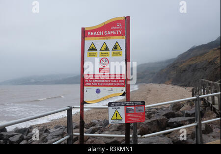 Beach safety sign at the famous Jurassic coast beach between Charmouth and Lyme Regis in West Dorset UK - Stock Image