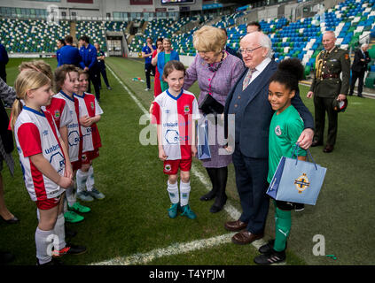 Irish President Michael D Higgins and his wife Sabina Coyne at pitch side in the National Stadium at Windsor Park, Belfast, meeting players from the Cliftonville and Linfield U9 girls' teams. - Stock Image