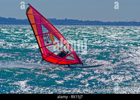 windsurfer at full speed during a strong windy day in mediterranean sea (St Laurent du Var , France) - Stock Image