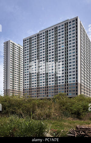 Economy housing high rise units Thailand - Stock Image