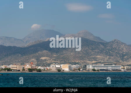 Crete, Greece. June 2019. Southern Crete and the town of Ierapetra with the Church of Agia Fotini and mountains close to the waterfront - Stock Image