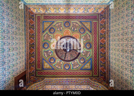 Royal era colorful engraved wooden ceiling with floral pattern decorations at historic Manial palace of Prince Mohammed Ali, Cairo, Egypt - Stock Image