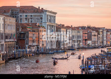 the Grande canal in Venice under the sunset with venetian gondolas paddling away in the distance - Stock Image