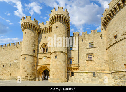 Tourists enter the medieval Palace of the Grand Master of the Knights of Rhodes also known as Kastello on the Mediterranean island of Rhodes Greece - Stock Image