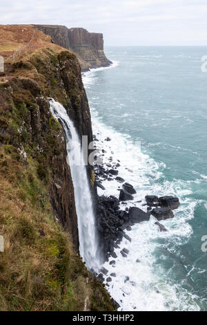 Mealt Falls with Kilt Rock sea-cliffs in background on east coast of Isle of Skye, Highland Region, Scotland, UK - Stock Image