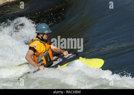 Kayaker plays in a water trough. At the Whitewater feature in the Mad River. Wagner Subaru Outdoor Experience at Eastwood Metro Park, Five Rivers Metr - Stock Image