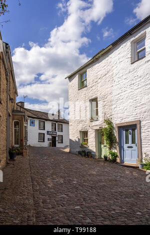 Dent village, Cumbria., Main street and Sun Inn. - Stock Image