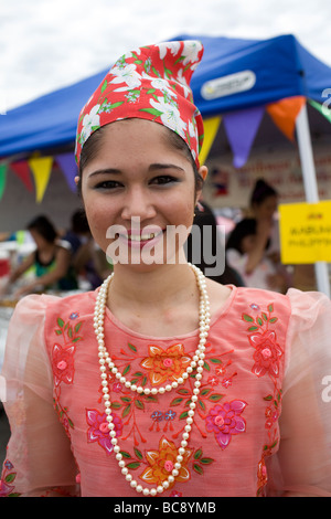 A Filipina wearing a traditional Maria Clara dress at a festival. - Stock Image