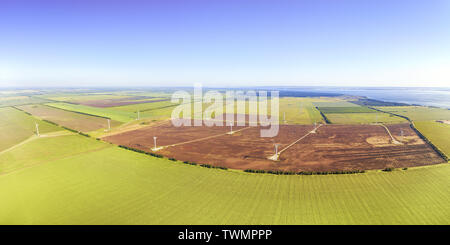 Large aerial panoramic landscape with wind power plant and green fields - Stock Image