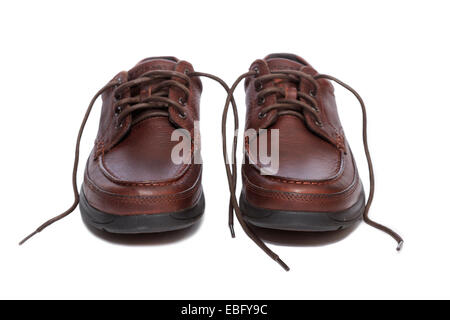 A pair of oxford style shoes with untied laces - Stock Image
