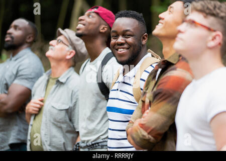 Portrait smiling, confident man hiking with friends - Stock Image