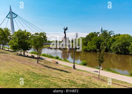 Keeper of the Plains, a steel sculpture by Blackbear Bosin. Wichita, Kansas, USA. From the south shore of the Arkansas River. - Stock Image