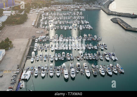 Yatch harbor marina pier and boat dock yatchs and vessels awaiting the open sea. Aerial drone view looking straight down above T-Head. - Stock Image