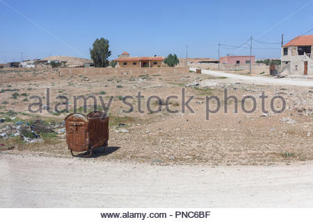 Rusted Rubbish Bins on Road Side in Small Jordan Community near Amman - Stock Image