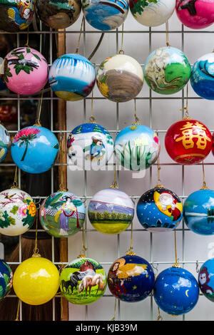 Hanging christmas tree decorations (baubles) on sale in Chinatown, Singapore - Stock Image