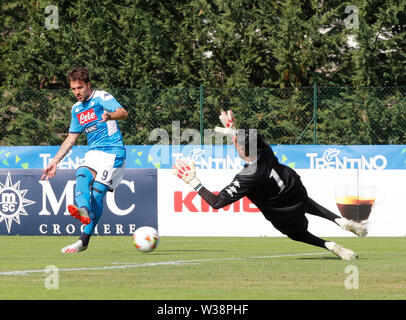 Stadium Carciato, Dimaro, Italy. 13th July, 2019. Pre-season football freindly, Napoli versus Benevento; Simone Verdi of Napoli shoots but his effort saved by goalkeeper Christian Puggioni of Benevento Credit: Action Plus Sports/Alamy Live News - Stock Image