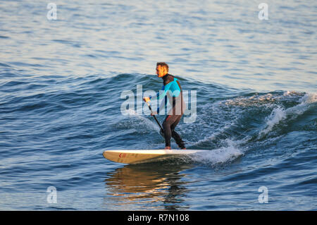 Surfers surfing in Estoril Cascais Portugal - Stock Image