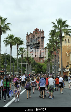 Crowds move toward Hollywood Tower Hotel ride at Disney's Hollywood Studios, Orlando, Florida, USA - Stock Image
