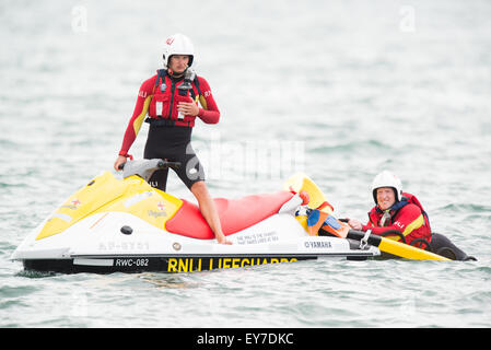 Portsmouth, UK. 23rd July 2015. RNLI Lifeguards on jet bikes patrol the waterfront for spectator safety as the America's - Stock Image