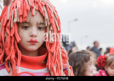 Portrait of the beautiful face of a young girl in a red wig with make-up - Mealhada Carnaval/ Carnival street parade - Stock Image