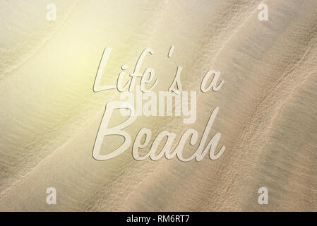 full frame image of a beach sand with LIFE'S A BEACH word. concept of holiday, travel and wanderlust - Stock Image