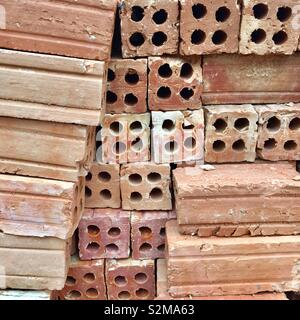 Bricks stacked up on a building site in Laos - Stock Image