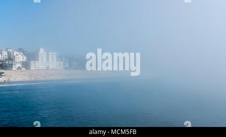 Sudden fog covering almost entirely the Venice Beach towards Santa Monica Beach and Pier, Los Angeles, California, USA - Stock Image