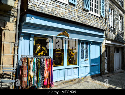 Blue-painted front facade of a small brocante in a narrow street in Morlaix, Brittany, France. - Stock Image