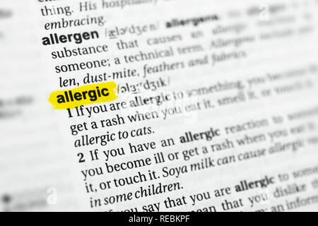 Highlighted English word 'allergic' and its definition at the dictionary. - Stock Image