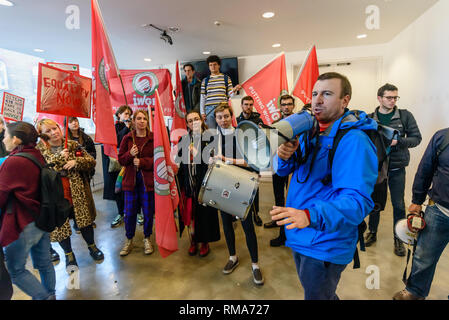 London, UK. 14th February 2019.General Secretary of the IWGB, Jason Moyer-Lee speaks in the foyer of the Ben Pimlott Building, briefly occupied as the IWGB union and students launch their campaign for Goldmsiths, University of London, to directly employ its security officers. Currently they are employed by CIS Security Ltd on low pay and minimal conditions of service, and CIS routinely flouts its legal responsibilities on statutory sick pay and holidays. Credit: Peter Marshall/Alamy Live News - Stock Image
