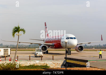 Siem Reap, Cambodia - 16th January 2018: Air Asia aeroplane arriving at Siem Reap airport. The airline operates flights to Thailand and Malaysia. - Stock Image