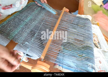 A loom turning spun sheeps wool into a shawl at the Sheep to Shawl Challenge taking place at Orford Ness, Suffolk, UK - Stock Image