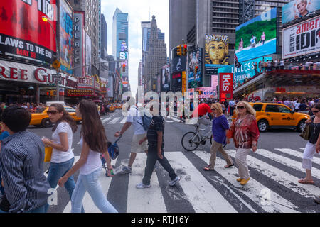 Pedestrian in a zebra crossing in 7th avenue, Manhattan, New York, USA - Stock Image