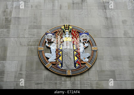View from street level of huge enamelled metal, Art Deco plaque depicting 'Drama', on wall of Radio City - Stock Image