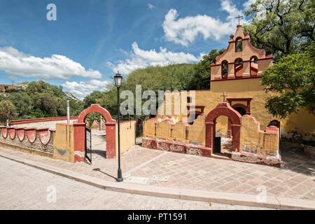 The Capilla de las animas or Chapel of Souls church in the beautiful colonial village of Bernal, Queretaro, Mexico. Bernal is a quaint colonial town known for the Pena de Bernal, a giant monolith which dominates the tiny village is the third highest on the planet. - Stock Image