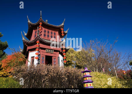 The Tower of Condensing Clouds pavilion and The Magic of Lanterns exhibit in the Chinese Garden in autumn, Montreal Botanical Garden, Quebec, Canada - Stock Image