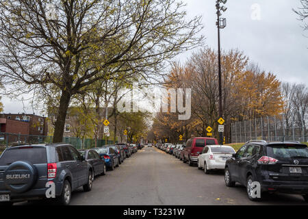 MONTREAL, CANADA - NOVEMBER 9, 2018: Typical north American residential street in autumn in Cote des Neiges Montreal, Quebec, during an autumn afterno - Stock Image