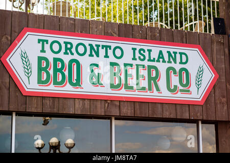 Toronto Island BBQ & Beer Co. sign on the wall of the eponymous pub. - Stock Image